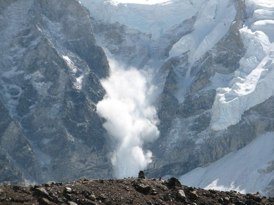 Avalanche: Large amount of snow sliding down a steep slope