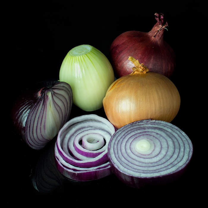 Onion: Bulb of a flowering plant in the family Amaryllidaceae used as a vegetable